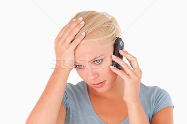 Sad woman on a phone in a studio Stock photo © wavebreak_media