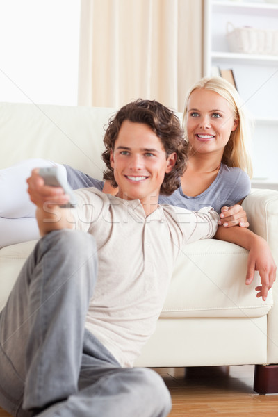 Portrait of a cute couple watching the television in their living room Stock photo © wavebreak_media