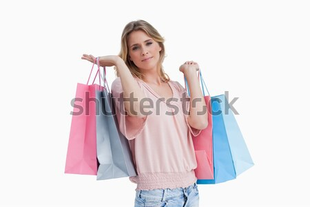 Dark-haired woman posing with shopping bags against a white background Stock photo © wavebreak_media