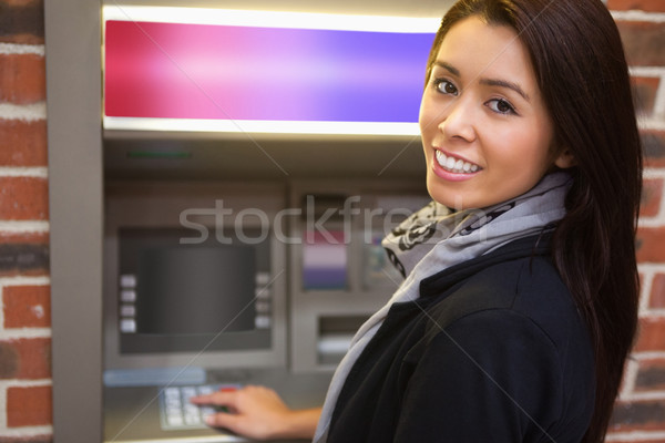 Woman withdrawing cash at an ATM Stock photo © wavebreak_media