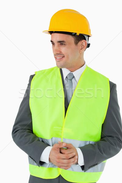 Uśmiechnięty architekta ręce fałdowy patrząc strona Zdjęcia stock © wavebreak_media