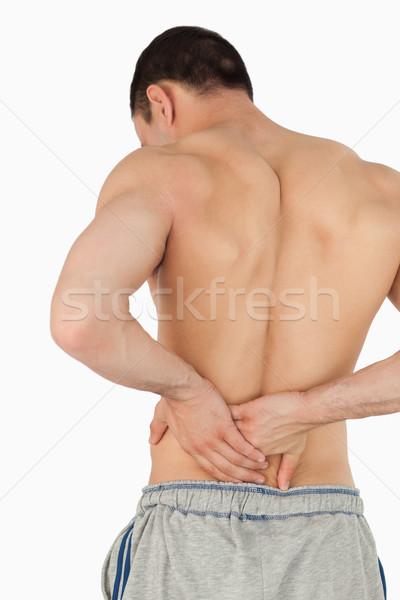 Jóvenes masculina sufrimiento dolor de espalda blanco mano Foto stock © wavebreak_media