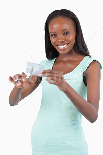 Smiling woman solving her financial problems against a white background Stock photo © wavebreak_media