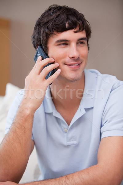 Young man answering phonecall Stock photo © wavebreak_media