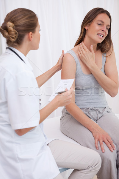 Patient showing painful spot to doctor Stock photo © wavebreak_media