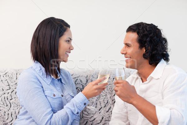 Young couple drinking sparkling wine Stock photo © wavebreak_media