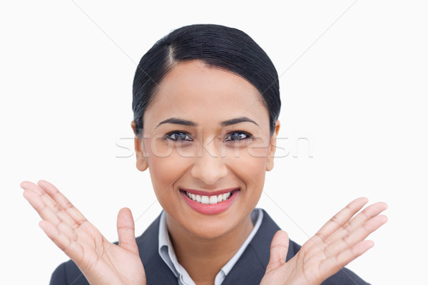 Close up of positive surprised saleswoman against a white background Stock photo © wavebreak_media