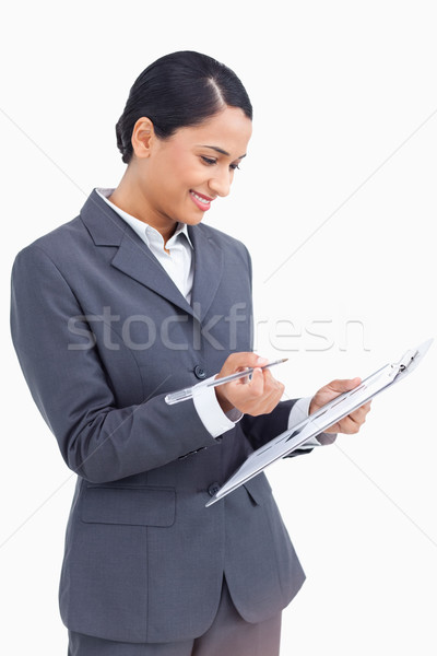 Stock photo: Close up of saleswoman with clipboard and pen against a white background