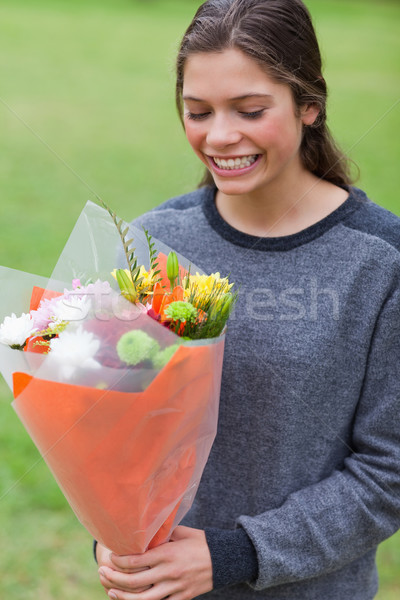 Young smiling girl receiving a beautiful bunch of flowers Stock photo © wavebreak_media