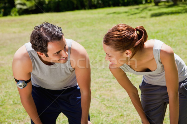 Man and a woman bending over as they recover while looking at each other Stock photo © wavebreak_media