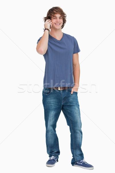 Heureux Homme étudiant téléphone blanche Photo stock © wavebreak_media