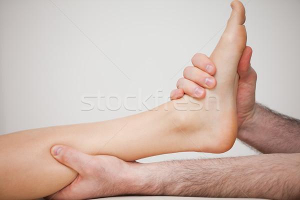Foot being held by a doctor indoors Stock photo © wavebreak_media