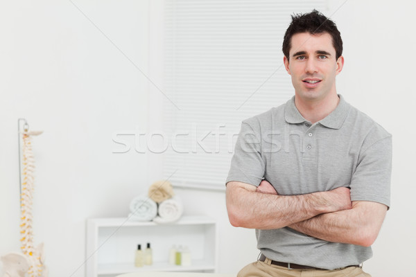 Peaceful doctor crossing his arms in his medical room Stock photo © wavebreak_media