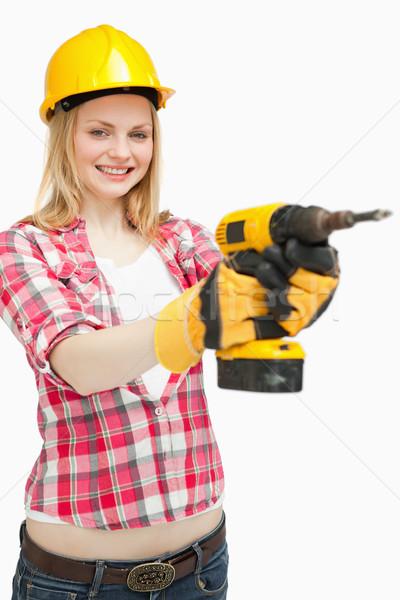 Kobieta elektryczne śrubokręt uśmiechnięty biały strony Zdjęcia stock © wavebreak_media