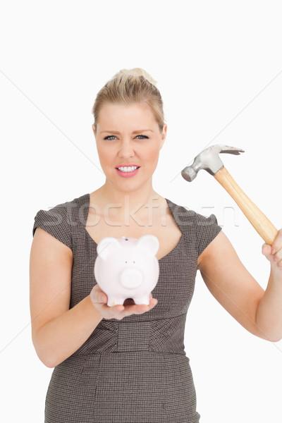 Concentré femme pause tirelire blanche costume Photo stock © wavebreak_media