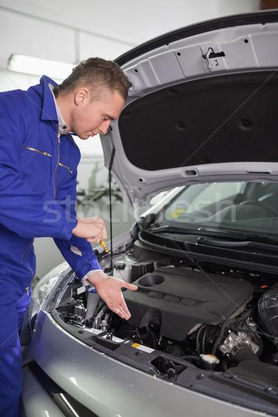 Mechanic showing an engine in a garage Stock photo © wavebreak_media