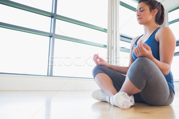 Woman sitting on the floor medtiating Stock photo © wavebreak_media