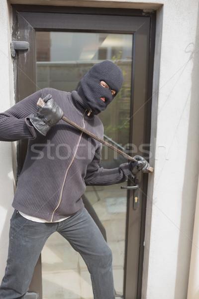 Burglar breaking into home using crow bar through back door Stock photo © wavebreak_media