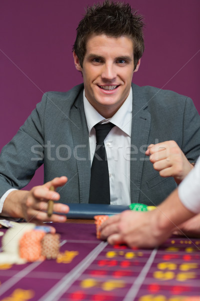 Stock photo: Man winning at roulette in casino