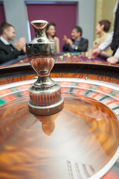 Rueda de la ruleta alrededor casino dinero hombre femenino Foto stock © wavebreak_media