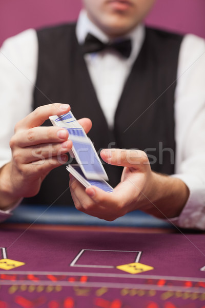 Cards being shuffled by dealer at casino Stock photo © wavebreak_media