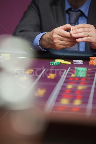 Homem roleta cassino dinheiro jogar Foto stock © wavebreak_media