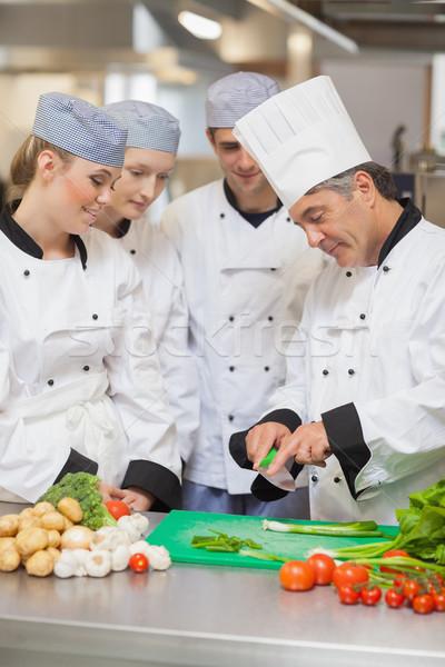 Kucharz nauczania cięcia warzyw kuchnia tle Zdjęcia stock © wavebreak_media
