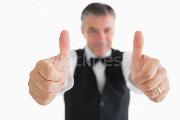 Cheerful waiter having thumbs up in front of camera Stock photo © wavebreak_media