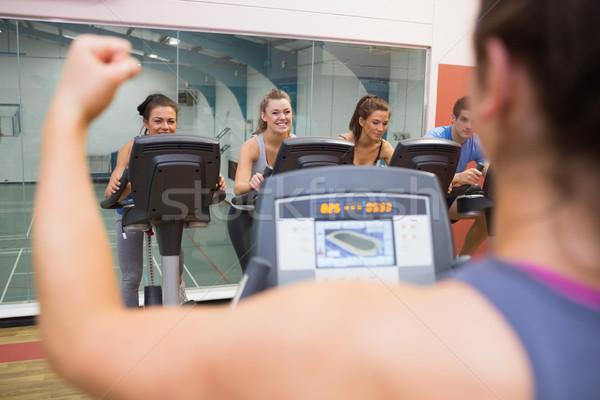 Happy people in spinning class Stock photo © wavebreak_media