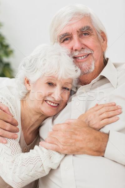 улыбаясь пару диване пожилого дома любви Сток-фото © wavebreak_media