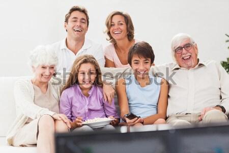 семьи диване смотрят телевизор улыбаясь Сток-фото © wavebreak_media
