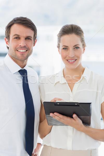 Smartly dressed colleagues using digital tablet Stock photo © wavebreak_media