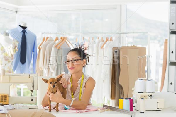 Beautiful female fashion designer with chihuahua Stock photo © wavebreak_media