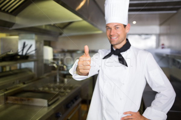 Smiling male cook gesturing thumbs up in kitchen Stock photo © wavebreak_media