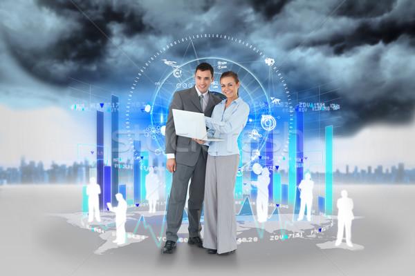 Feliz equipe de negócios usando laptop gráfico de barras humanismo composição digital Foto stock © wavebreak_media