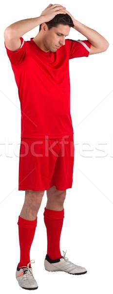 Teleurgesteld voetballer naar beneden te kijken witte man voetbal Stockfoto © wavebreak_media