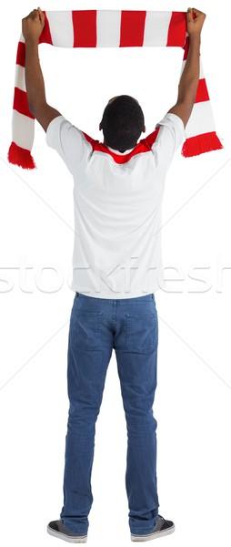 Heureux football fan écharpe blanche Photo stock © wavebreak_media
