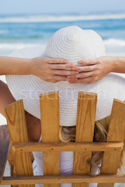 Woman sitting in deck chair at the beach Stock photo © wavebreak_media
