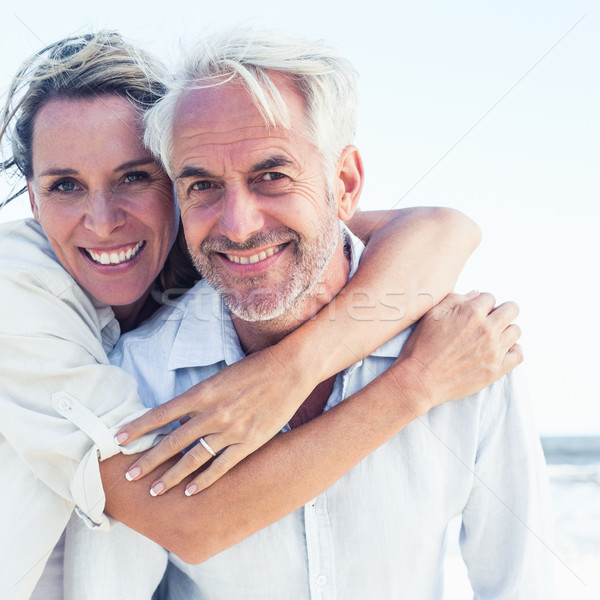 Attractive married couple posing at the beach Stock photo © wavebreak_media