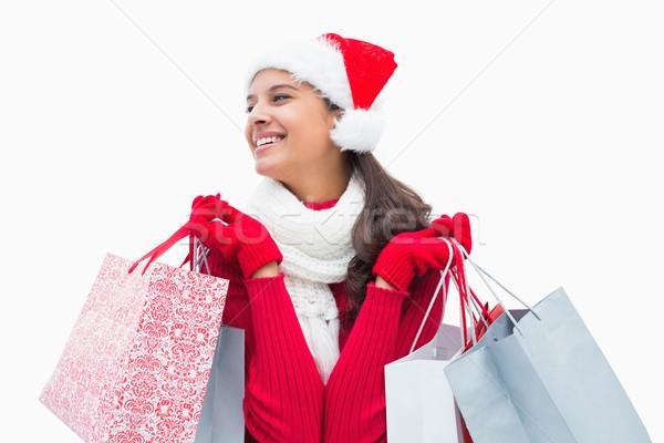 Gyönyörű ünnepi nő tart bevásárlótáskák fehér Stock fotó © wavebreak_media