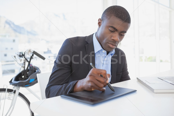Focused designer drawing on digitizer Stock photo © wavebreak_media