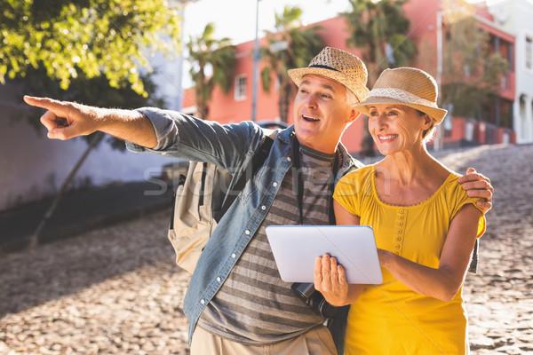 Happy tourist couple using tablet pc in the city Stock photo © wavebreak_media
