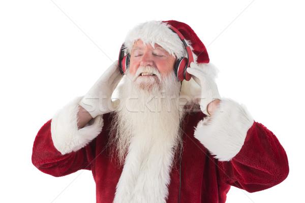 Santa Claus enjoys some music Stock photo © wavebreak_media