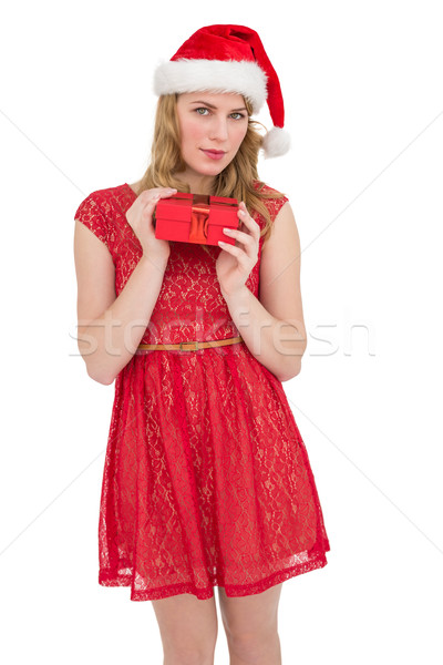 Blonde woman in santa hat standing with gift Stock photo © wavebreak_media