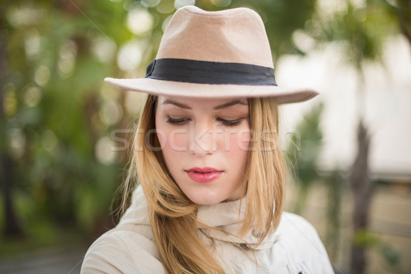 Pretty blonde woman with hat posing while looking down Stock photo © wavebreak_media