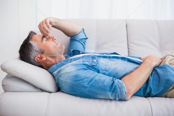 Człowiek siwe włosy relaks kanapie domu salon Zdjęcia stock © wavebreak_media