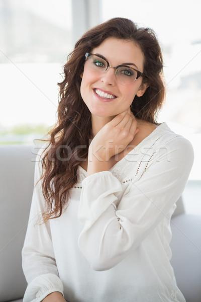 Gülen işkadını okuma gözlükleri kanepe ofis iş Stok fotoğraf © wavebreak_media
