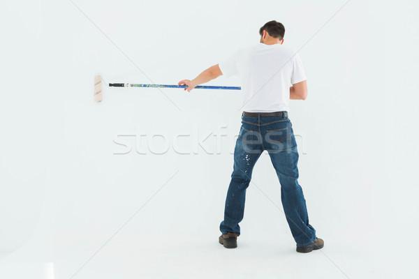 Homem pintar branco pintura Foto stock © wavebreak_media
