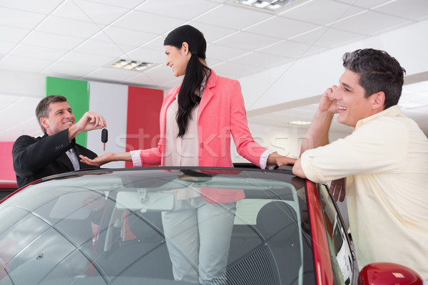 Cheerful woman standing in red cabriolet  Stock photo © wavebreak_media