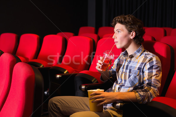 Young man watching a film Stock photo © wavebreak_media